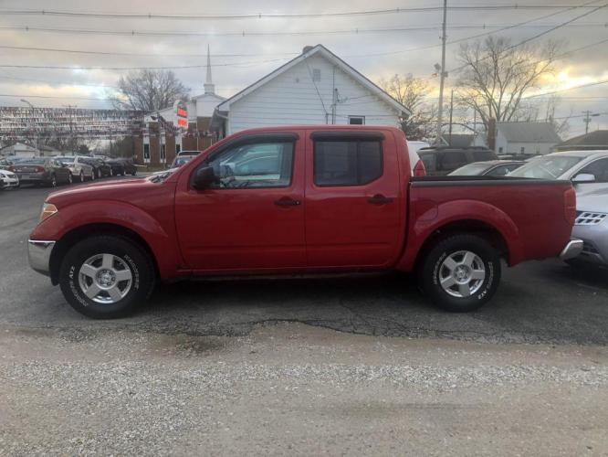 2007 RED NISSAN FRONTIER CREW CAB LE (1N6AD07U67C) with an 4.0L engine, Automatic transmission, located at 1056 E Riverside Dr, Evansville, IN, 47714, (812) 423-7026, 0.000000, 0.000000 - Photo #0